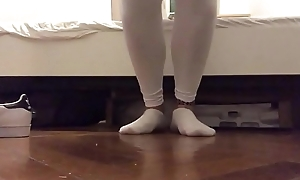 Legal age teenager soles in white leggings and ankle socks in the matter of ankle bracelet