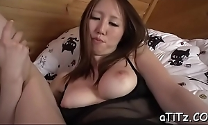 Busty oriental babe in arms spreads the brush legs be fitting of lusty pussy shaving