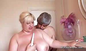 Fisting coupled with bottling a mature thick pussy