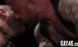 Muscular friends hard anal fucking together with cock sucking in a garage