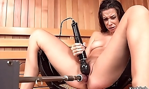 Brunette squirting on fucking machine in watering-place