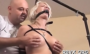 Busty cutie gets greatly horny while being bounded tight