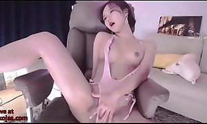 Korean stunner masturbates in pink swimsuit