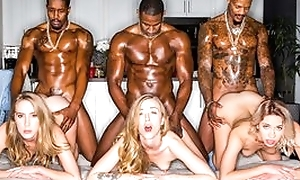 Duo astounding blonde ladies servicing muscled ebony dudes