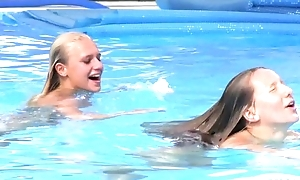 Two superb girls swimming and licking hard by dramatize expunge pool