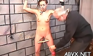 Unspecified screams with girder smashing her pussy in extreme bondage